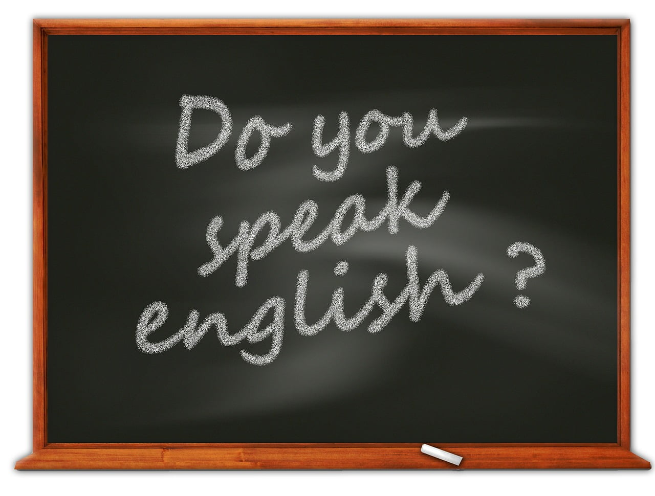 Tablica szkolna z napisanym zdaniem: Do you speak english?