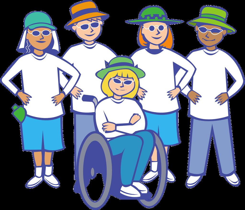 dziewczynka na wóżku inwalidzkim, wokół koledzy